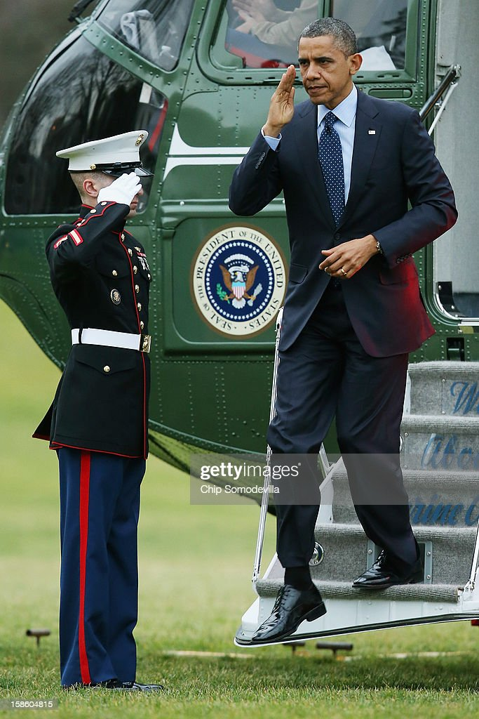 U.S. President Barack Obama disembarks from Marine One on the South Lawn of the White House December 20, 2012 in Washington, DC. According to the White House, Obama traveled to Walter Reed National Military Medical Center to visit ''wounded warriors who are being treated at the hospital and their families.''