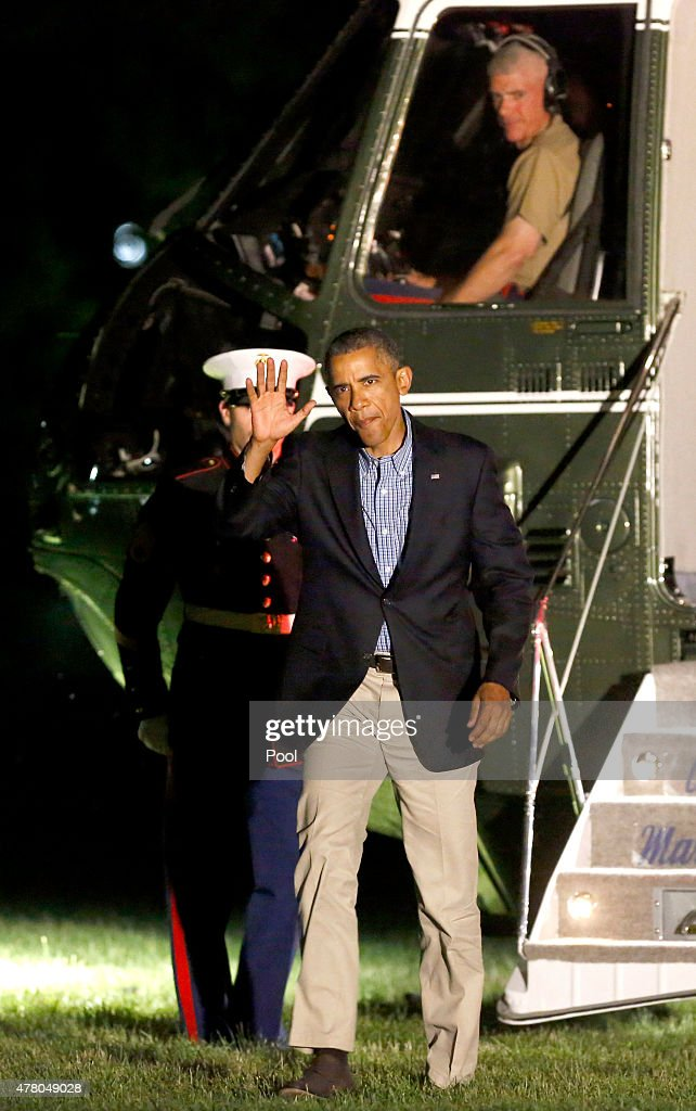 U.S. President Barack Obama disembarks from Marine One while returning to the White House June 21 2015, in Washington, DC. Obama is returning from a trip to Los Angeles and San Francisco, attending DNC events and speaking at the annual U.S. Conference of Mayors in San Francisco.