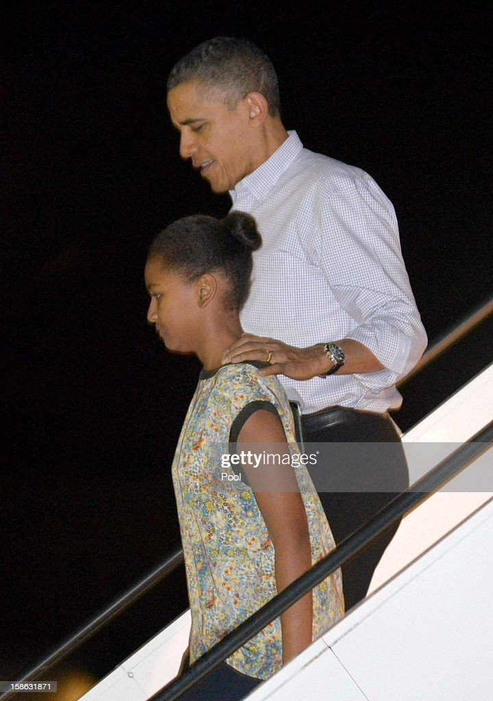 US President <a gi-track='captionPersonalityLinkClicked' href=/galleries/search?phrase=Barack+Obama&family=editorial&specificpeople=203260 ng-click='$event.stopPropagation()'>Barack Obama</a> disembarks Obama Air Force One with daughter Natasha at Joint Base Pearl Harbor-Hickam on December 22, 2012 in Honolulu, Hawaii. Hawaii. The president and his family spend the Christmas holiday in Hawaii, Obama's birthplace.