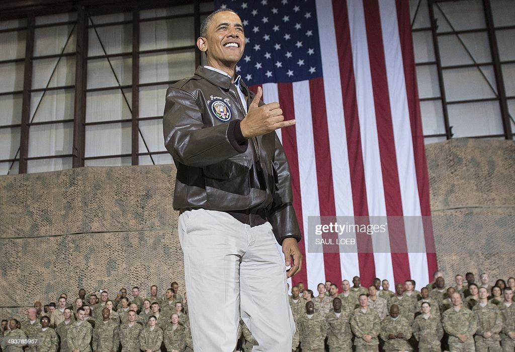 US President <a gi-track='captionPersonalityLinkClicked' href=/galleries/search?phrase=Barack+Obama&family=editorial&specificpeople=203260 ng-click='$event.stopPropagation()'>Barack Obama</a> does a Hawaiian 'shaka' as he greets US troops during a surprise visit to Bagram Air Field, north of Kabul, in Afghanistan, May 25, 2014, prior to the Memorial Day holiday. AFP PHOTO / Saul LOEB
