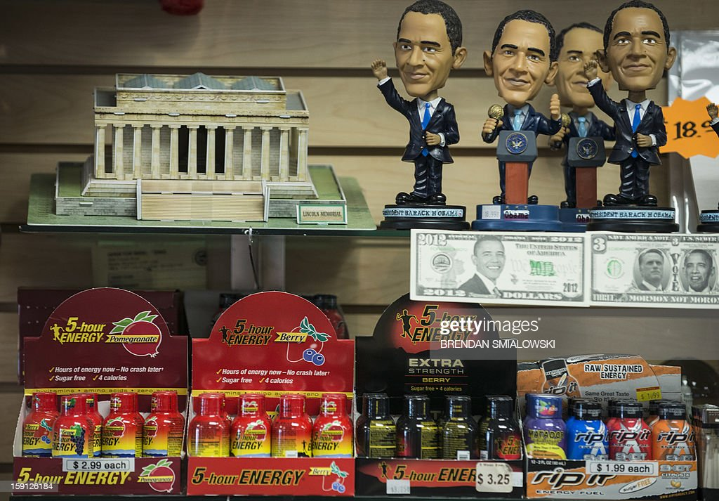 US President Barack Obama dolls, fake money and other items are seen at the Souvenir World shop in Washington on January 8, 2013. Preparations continue for Obama's inauguration for his second term on January 21. AFP PHOTO/Brendan SMIALOWSKI