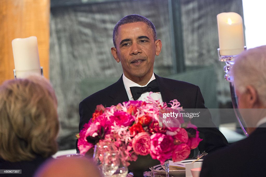 President <a gi-track='captionPersonalityLinkClicked' href=/galleries/search?phrase=Barack+Obama&family=editorial&specificpeople=203260 ng-click='$event.stopPropagation()'>Barack Obama</a> eats dinner with recipients of the Medal of Freedom at the Smithsonian National Museum of American History on November 20, 2013 in Washington, DC. The Presidential Medal of Freedom is the nation's highest civilian honor, presented to individuals who have made meritorious contributions to the security or national interests of the United States, to world peace, or to cultural or other significant public or private endeavors.