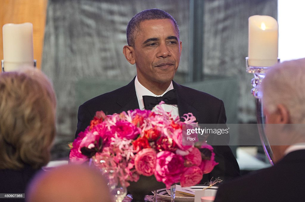 President Barack Obama eats dinner with recipients of the Medal of Freedom at the Smithsonian National Museum of American History on November 20, 2013 in Washington, DC. The Presidential Medal of Freedom is the nation's highest civilian honor, presented to individuals who have made meritorious contributions to the security or national interests of the United States, to world peace, or to cultural or other significant public or private endeavors.
