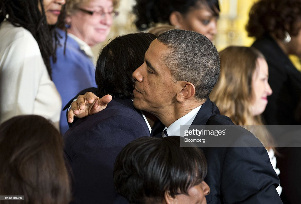U.S. President <a gi-track='captionPersonalityLinkClicked' href=/galleries/search?phrase=Barack+Obama&family=editorial&specificpeople=203260 ng-click='$event.stopPropagation()'>Barack Obama</a> embraces an attendee during an event in the East Room of the White House in Washington, D.C., U.S., on Thursday, March 28, 2013. Obama, with families of victims of the Connecticut school shooting tragedy at his side, pressed the Senate to pass gun-control legislation next month and urged lawmakers to resist any weakening of resolve. Photographer: Joshua Roberts/Bloomberg via Getty Images