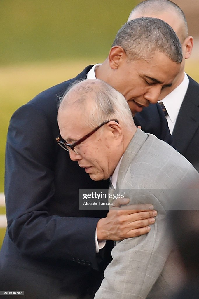 U.S. President <a gi-track='captionPersonalityLinkClicked' href=/galleries/search?phrase=Barack+Obama&family=editorial&specificpeople=203260 ng-click='$event.stopPropagation()'>Barack Obama</a> embraces atomic bomb survivor Shigeaki Mori during his visit to the Hiroshima Peace Memorial Park on May 27, 2016 in Hiroshima, Japan. It is the first time U.S. President makes an official visit to Hiroshima, the site where the atomic bomb was dropped in the end of World War II on August 6, 1945.