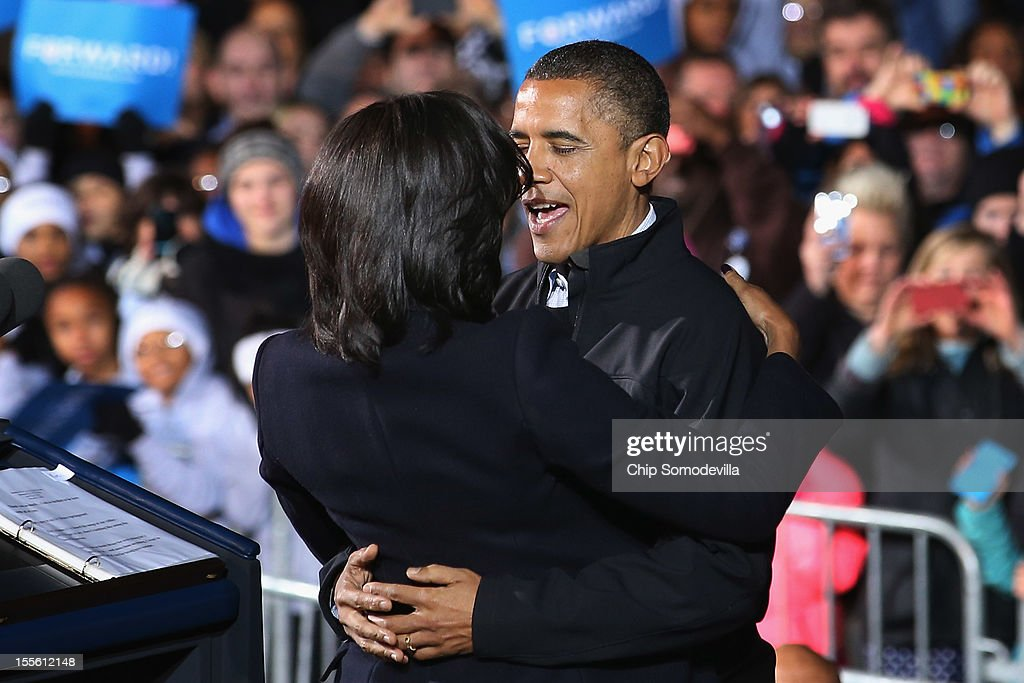 U.S. President <a gi-track='captionPersonalityLinkClicked' href=/galleries/search?phrase=Barack+Obama&family=editorial&specificpeople=203260 ng-click='$event.stopPropagation()'>Barack Obama</a> embraces first lady <a gi-track='captionPersonalityLinkClicked' href=/galleries/search?phrase=Michelle+Obama&family=editorial&specificpeople=2528864 ng-click='$event.stopPropagation()'>Michelle Obama</a> during his last rally the night before the general election November 5, 2012 in Des Moines, Iowa. The rally was held just outside Obama's first headquarters from the 2008 campaign, where his first march to the White House started. Obama and his opponent, Republican presidential nominee and former Massachusetts Gov. Mitt Romney are stumping from one 'swing state' to the next in a last-minute rush to persuade undecided voters.