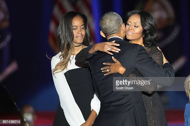 President Barack Obama embraces his wife Michelle and daughter Malia following his farewell speech to the nation on January 10 2017 in Chicago...