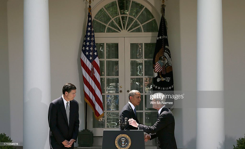 U.S. President <a gi-track='captionPersonalityLinkClicked' href=/galleries/search?phrase=Barack+Obama&family=editorial&specificpeople=203260 ng-click='$event.stopPropagation()'>Barack Obama</a> (C) embraces outgoing FBI Director Robert Mueller (R) as FBI Director nominee James Comey (L) looks on during a ceremony announcing Comey's nomination in the Rose Garden of the White House June 21, 2013 in Washington, DC. Comey is a former Justice Department official in the administration of former U.S. President George W. Bush.