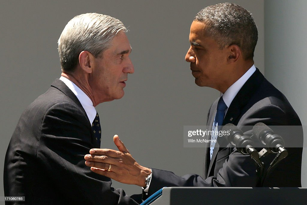 U.S. President <a gi-track='captionPersonalityLinkClicked' href=/galleries/search?phrase=Barack+Obama&family=editorial&specificpeople=203260 ng-click='$event.stopPropagation()'>Barack Obama</a> (R) embraces outgoing FBI Director Robert Mueller during a ceremony announcing Mueller's replacement, James Comey, in the Rose Garden of the White House June 21, 2013 in Washington, DC. Comey is a former Justice Department official in the administration of former U.S. President George W. Bush.