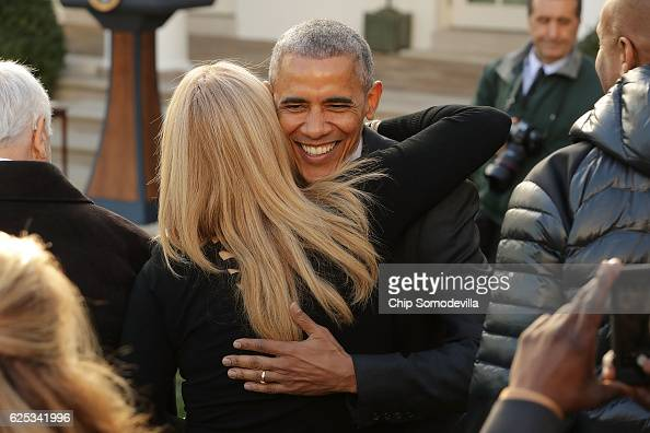 S President Barack Obama embraces sisterinlaw Kelly Robinson after he pardoned the National Thanksgiving Turkey in a ceremony in the Rose Garden at...