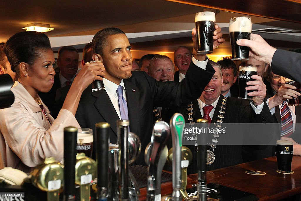 S President Barack Obama enjoys a glass of Guinness in his ancestral home of Moneygall alongside First Lady Michelle Obama on May 23 2011 in...