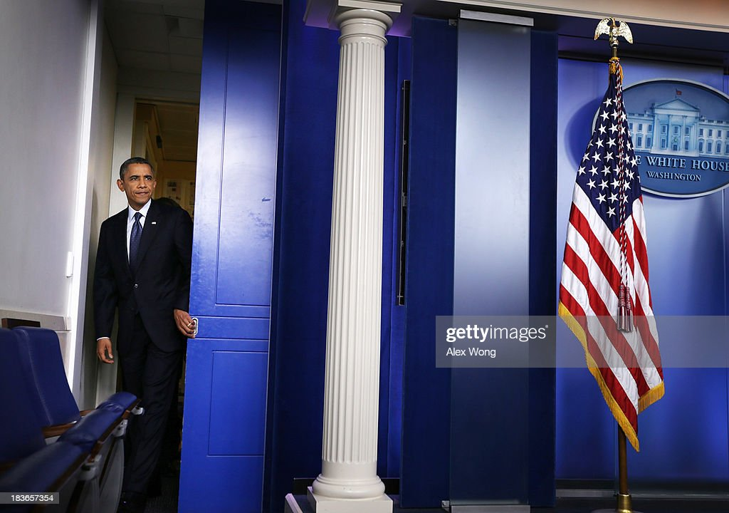 U.S. President <a gi-track='captionPersonalityLinkClicked' href=/galleries/search?phrase=Barack+Obama&family=editorial&specificpeople=203260 ng-click='$event.stopPropagation()'>Barack Obama</a> enters the Brady Press Briefing Room of the White House for a news conference on October 8, 2013 in Washington, DC. Now in the eighth day of a government shutdown, Obama and his Democratic allies have reiterated to House Speaker John Boehner (R-OH) that they will negotiate but only after Republicans vote to approve a clean extension of government spending and authorize an increase in the debt limit.