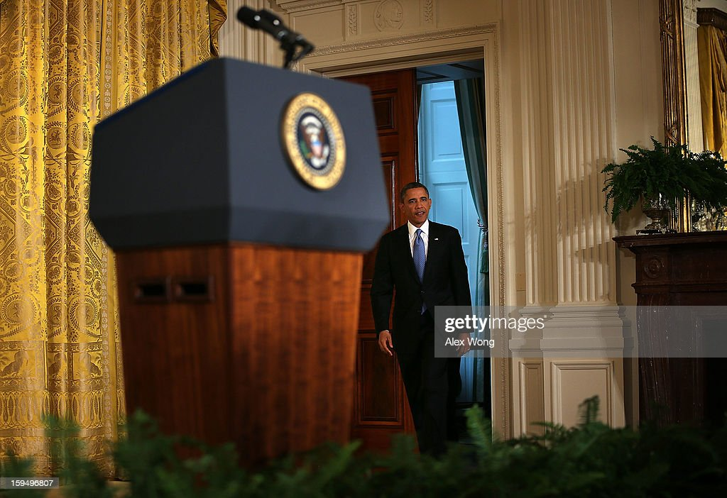 U.S. President <a gi-track='captionPersonalityLinkClicked' href=/galleries/search?phrase=Barack+Obama&family=editorial&specificpeople=203260 ng-click='$event.stopPropagation()'>Barack Obama</a> enters the East Room of the White House for his final news conference January 14, 2013 in Washington, DC. Obama spoke on the debt ceiling and deficit reduction during the news conference.