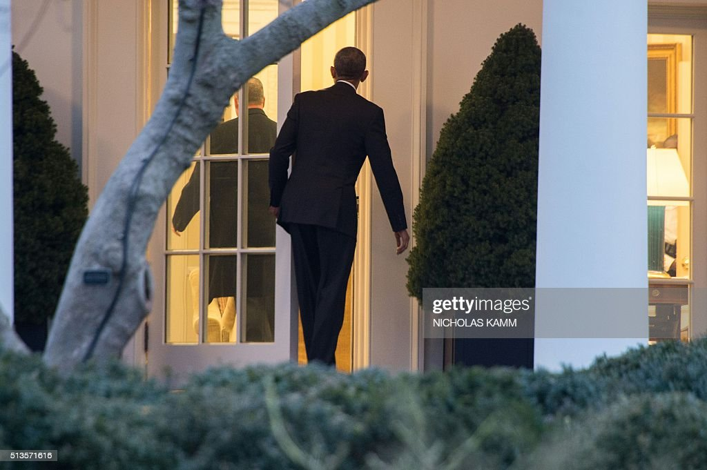 us president barack obama enters the oval office upon his return to the white house in barack obama enters oval
