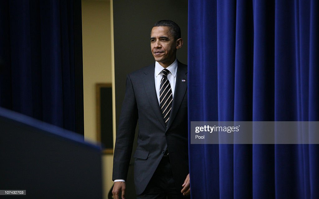 U.S. President <a gi-track='captionPersonalityLinkClicked' href=/galleries/search?phrase=Barack+Obama&family=editorial&specificpeople=203260 ng-click='$event.stopPropagation()'>Barack Obama</a> enters the White House South Court Auditorium before signing the Claims Resolution Act of 2010 along with administration officials, member of congress and congressional staff on December 8, 2010 in Washington, D.C. The bill will end a disputed Cobell v. Salazar Indian trust fund lawsuit against the federal government.