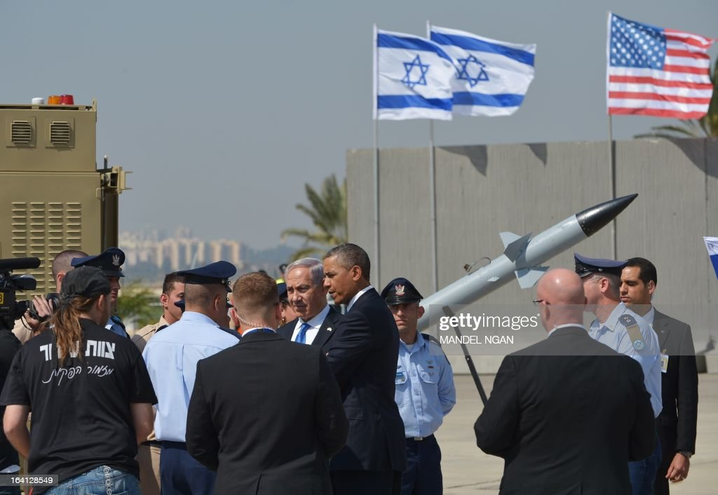 US President Barack Obama (C-R), escorted by Israeli Prime Minister Benjamin Netanyahu (C-L), view battery of Iron Dome, short-range missile defence system during a welcome ceremony at Ben Gurion International Airport on March 20, 2013 near Tel Aviv. Obama landed in Israel for the first time as US president, on a mission to ease past tensions with his hosts and hoping to paper over differences on handling Iran's nuclear threat.