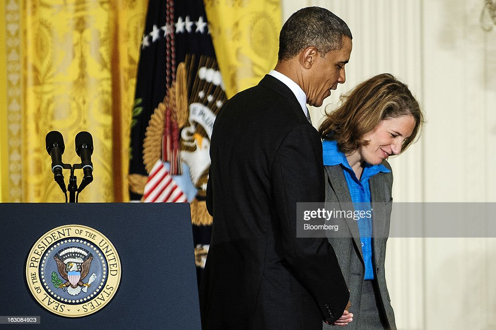 U.S. President <a gi-track='captionPersonalityLinkClicked' href=/galleries/search?phrase=Barack+Obama&family=editorial&specificpeople=203260 ng-click='$event.stopPropagation()'>Barack Obama</a> escorts Sylvia Mathews Burwell out of the East Room of the White House after making personnel announcements in Washington, D.C., U.S., on Monday, March 4, 2013. Obama announced three cabinet-level nominations, choosing Burwell of the Wal-Mart Foundation as director of the Office of Management and Budget, scientist Ernest Moniz as head of the Energy Department, and Gina McCarthy to lead the Environmental Protection Agency (EPA), where she's been an assistant administrator. Photographer: Pete Marovich/Bloomberg via Getty Images