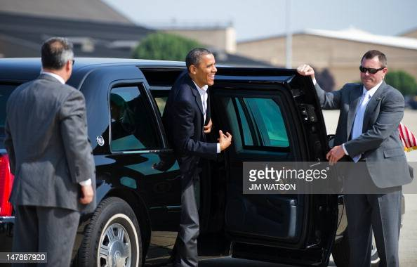 US President Barack Obama exits his limo at Joint Base Andrews Maryland to board Air Force One July 5 2012 en route to Toledo Ohio to attend campaign...