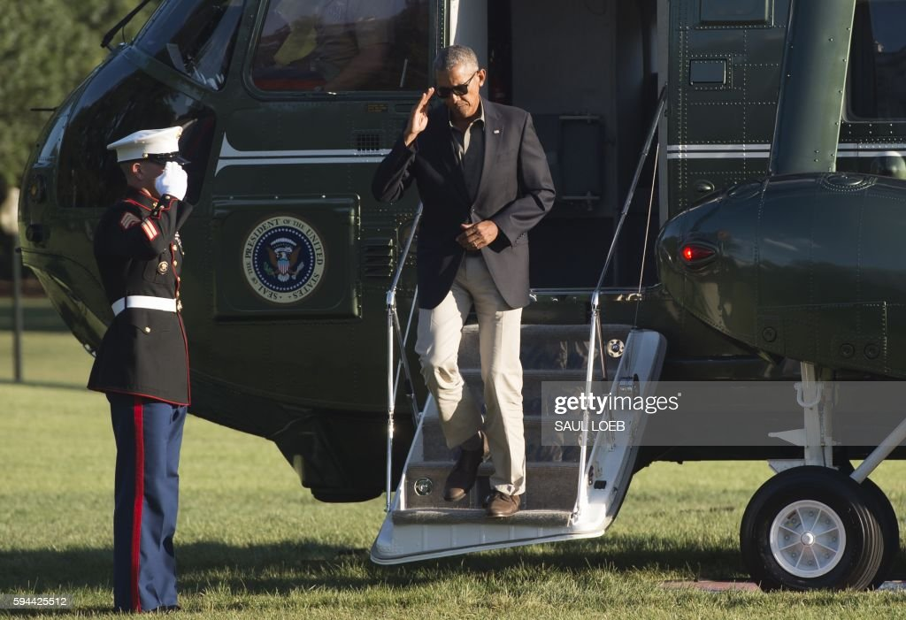 President Barack Obama exits Marine One upon arrival on the South Lawn of the White House in Washington DC August 23 after traveling to Baton Rouge...