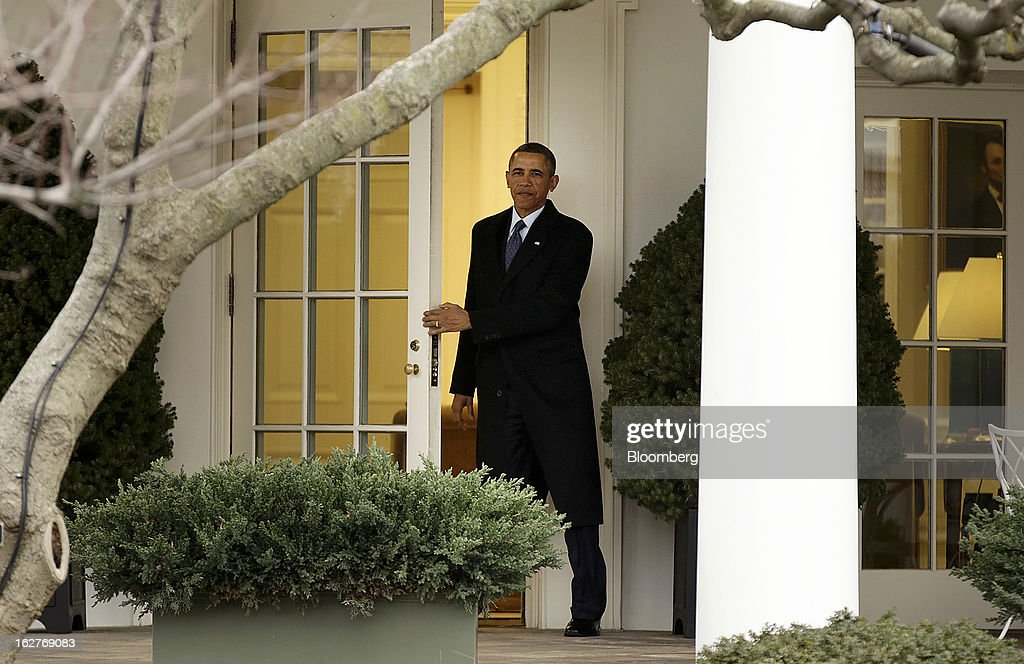 U.S. President Barack Obama exits the White House to board Marine One in Washington, D.C., U.S., on Tuesday, Feb. 26, 2013. With just three days before the $85 billion in reductions for this year are scheduled to start, Obama and Republicans led by House Speaker John Boehner yesterday traded blame again for the impasse. Photographer: Joshua Roberts/Bloomberg via Getty Images