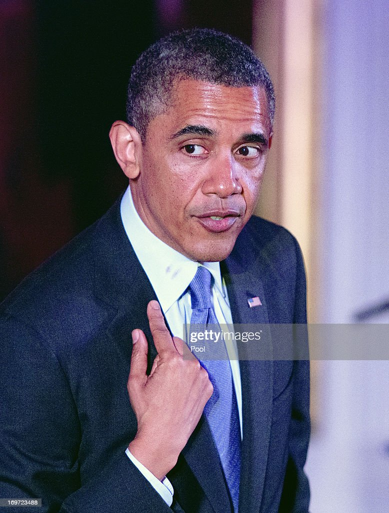 U.S. President <a gi-track='captionPersonalityLinkClicked' href=/galleries/search?phrase=Barack+Obama&family=editorial&specificpeople=203260 ng-click='$event.stopPropagation()'>Barack Obama</a> explains the lipstick on his collar as he delivers remarks at the Asian American and Pacific Islander (AAPI) Heritage Month Celebration in the East Room of the White House May 28, 2013 in Washington, D.C. Obama called again for immigration reform during his speech.