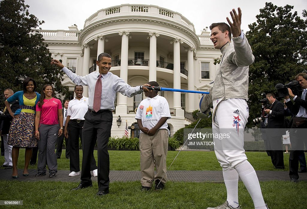 US President Barack Obama fences with US Olympic Fencer Tim Morehouse with a lightsaber during an event on Olympics Paralympics and youth sport on...