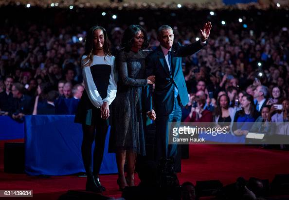 S President Barack Obama first lady Michelle Obama and daughter Malia Obama wave goodbye to supporters after Obama's farewell address at McCormick...