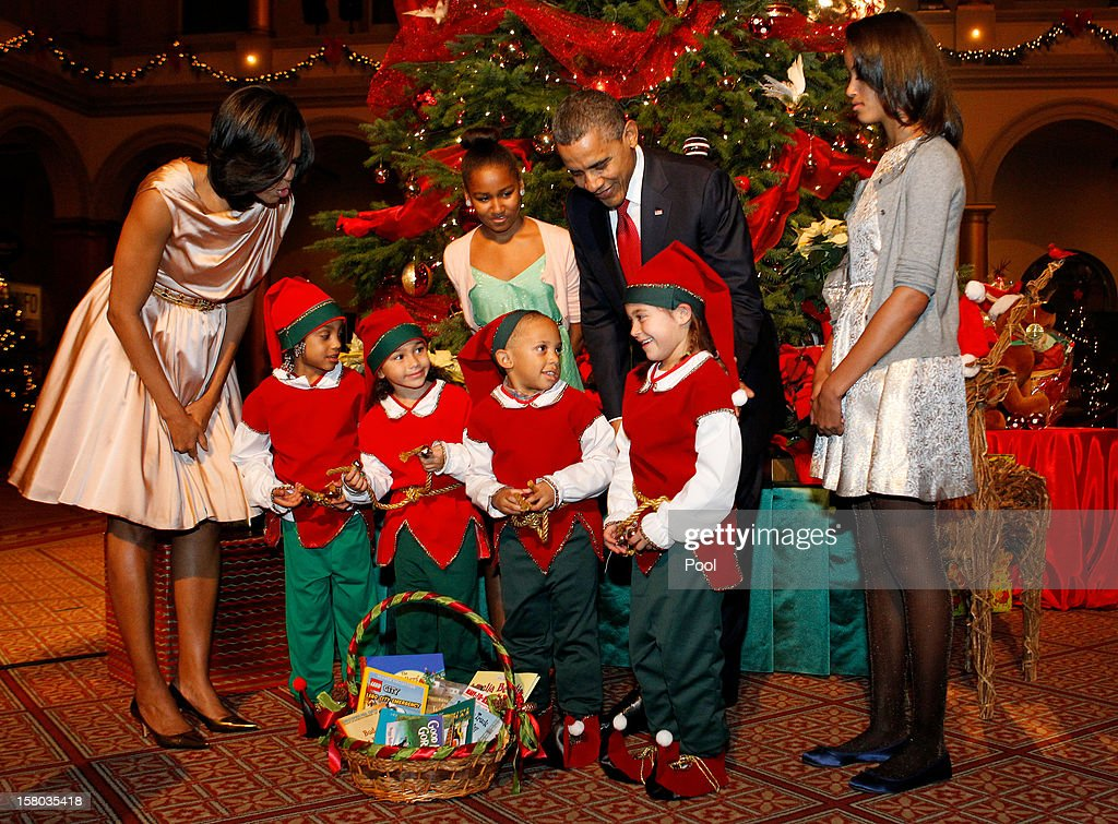 U.S. President <a gi-track='captionPersonalityLinkClicked' href=/galleries/search?phrase=Barack+Obama&family=editorial&specificpeople=203260 ng-click='$event.stopPropagation()'>Barack Obama</a> (2nd R), first lady <a gi-track='captionPersonalityLinkClicked' href=/galleries/search?phrase=Michelle+Obama&family=editorial&specificpeople=2528864 ng-click='$event.stopPropagation()'>Michelle Obama</a> (L), and daughters Malia (R) and Sasha (2nd L) greet Christmas elves as they attend the 'Christmas in Washington' concert at the National Building Museum on December 9, 2012 in Washington, D.C. The concert benefits the National Childrens Medical Center and is hosted by comedian Conan O'Brien.