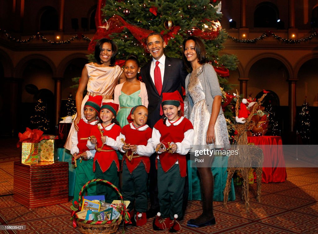 U.S. President Barack Obama (2nd R), first lady Michelle Obama (L), and daughters Malia (R) and Sasha (2nd L) greet Christmas elves as they attend the 'Christmas in Washington' concert at the National Building Museum on December 9, 2012 in Washington, D.C. The concert benefits the National Childrens Medical Center and is hosted by comedian Conan O'Brien.