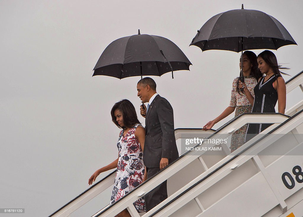 US President Barack Obama (2nd L), First Lady Michelle Obama (L) and daughters Malia (2nd R) and Sasha (R) disembark from Air Force One at the Jose Marti International Airport in Havana on March 20, 2016. Obama arrived in Cuba to bury the hatchet in a more than half-century-long Cold War conflict that turned the communist island and its giant neighbor into bitter enemies. AFP PHOTO/Nicholas KAMM / AFP / NICHOLAS