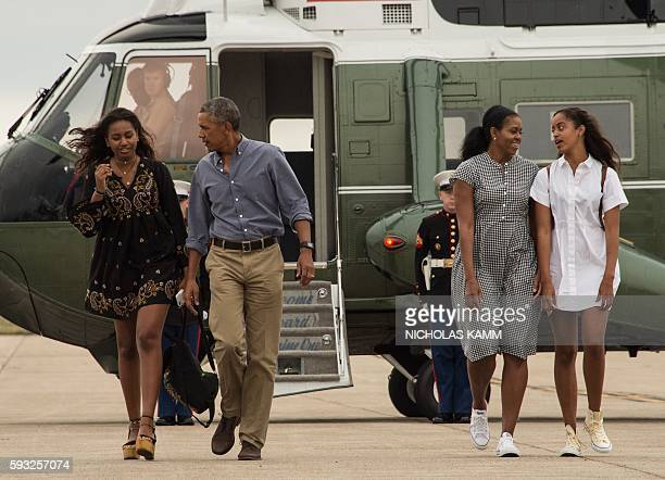 President Barack Obama First Lady Michelle Obama and daughters Malia and Sasha walk to board Air Force One at Cape Cod Air Force Station in...
