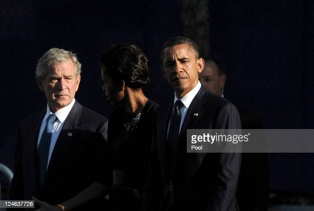 S President Barack Obama first Lady Michelle Obama and former President George W Bush walk past the North Pool of the 9/11 Memorial during the tenth...
