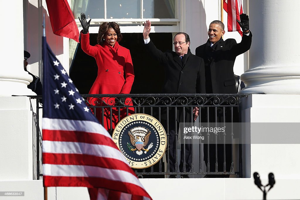 U.S. President <a gi-track='captionPersonalityLinkClicked' href=/galleries/search?phrase=Barack+Obama&family=editorial&specificpeople=203260 ng-click='$event.stopPropagation()'>Barack Obama</a> (R), first lady <a gi-track='captionPersonalityLinkClicked' href=/galleries/search?phrase=Michelle+Obama&family=editorial&specificpeople=2528864 ng-click='$event.stopPropagation()'>Michelle Obama</a> (L) and French President <a gi-track='captionPersonalityLinkClicked' href=/galleries/search?phrase=Fran%C3%A7ois+Hollande&family=editorial&specificpeople=543986 ng-click='$event.stopPropagation()'>François Hollande</a> (C) wave at the balcony of the White House during an arrival ceremony at the South Lawn February 11, 2014 in Washington, DC. President Hollande is on a three-day state visit to the U.S.