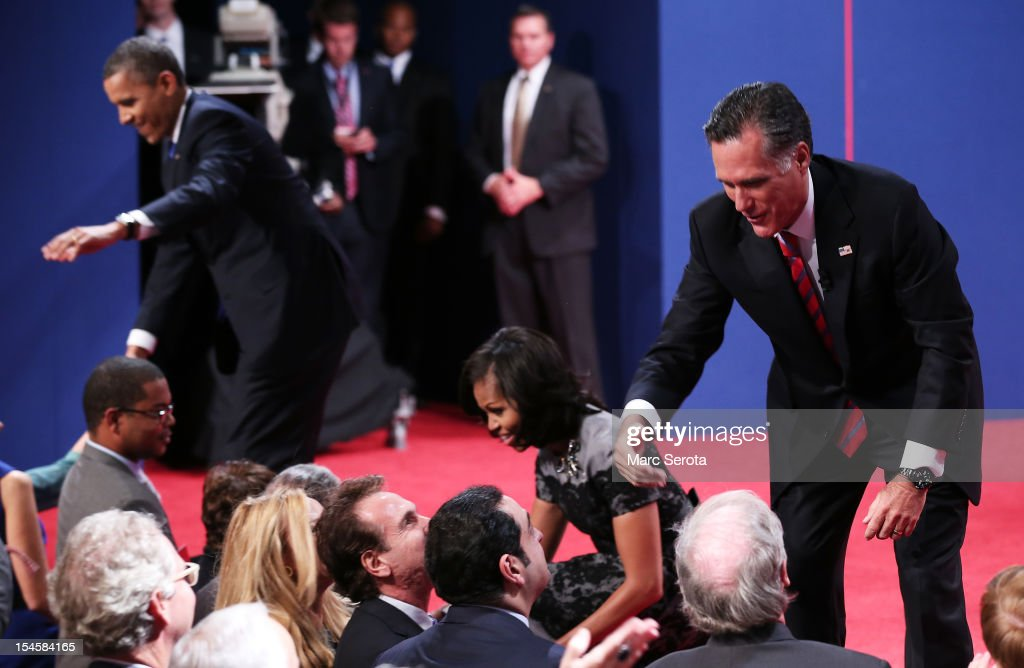 U.S. President <a gi-track='captionPersonalityLinkClicked' href=/galleries/search?phrase=Barack+Obama&family=editorial&specificpeople=203260 ng-click='$event.stopPropagation()'>Barack Obama</a> (L), first lady <a gi-track='captionPersonalityLinkClicked' href=/galleries/search?phrase=Michelle+Obama&family=editorial&specificpeople=2528864 ng-click='$event.stopPropagation()'>Michelle Obama</a>, and Republican presidential candidate <a gi-track='captionPersonalityLinkClicked' href=/galleries/search?phrase=Mitt+Romney&family=editorial&specificpeople=207106 ng-click='$event.stopPropagation()'>Mitt Romney</a> greet people after the debate at the Keith C. and Elaine Johnson Wold Performing Arts Center at Lynn University on October 22, 2012 in Boca Raton, Florida. The focus for the final presidential debate before Election Day on November 6 is foreign policy.