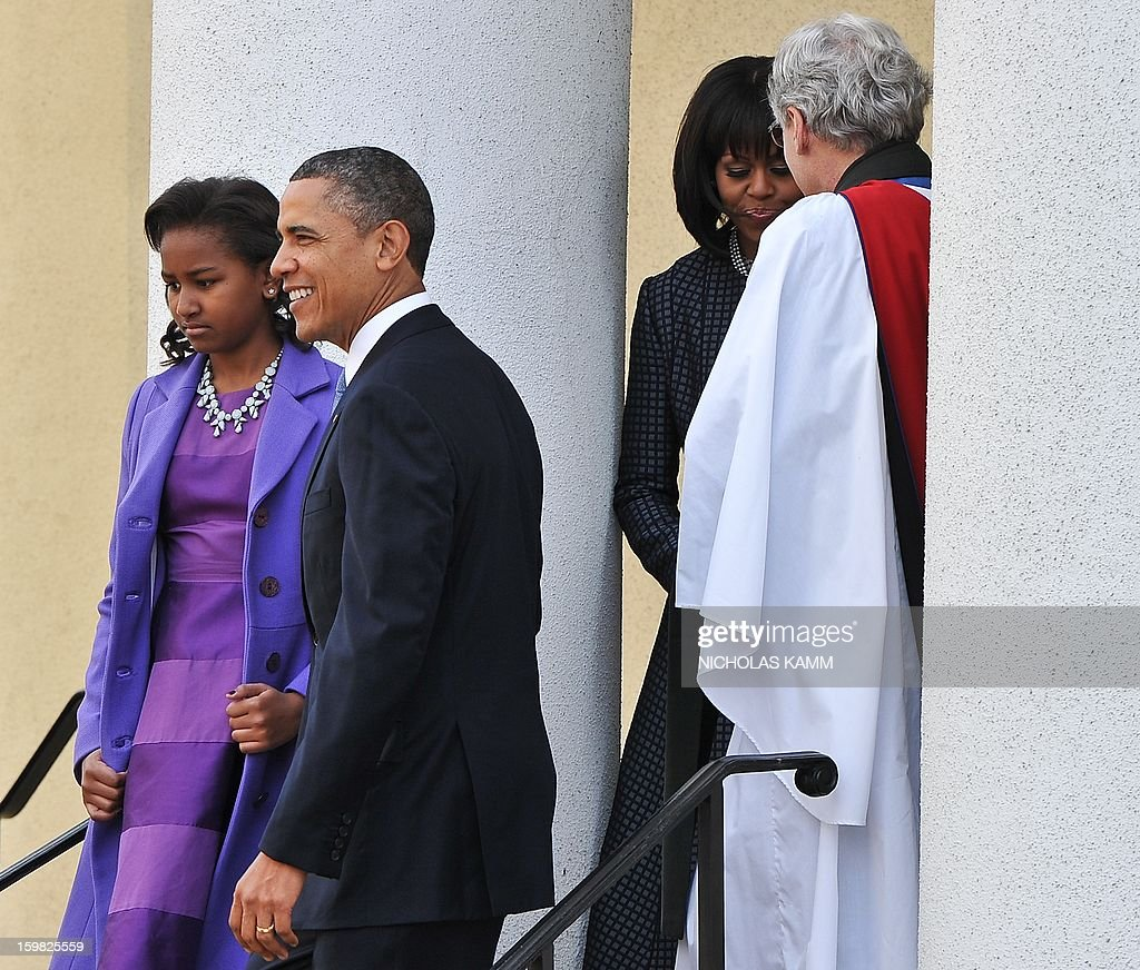US President Barack Obama, First Lady Michelle Obama and their daughter Sasha leave St. John's Church on January 21, 2013 in Washington, DC, hours before Obama participates in a ceremonial swearing in for a second term in office. AFP PHOTO/Nicholas KAMM