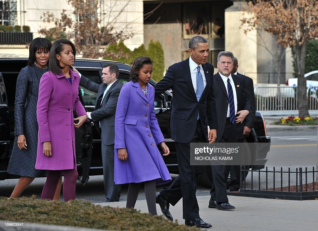 US President Barack Obama, First Lady Michelle Obama and their daughters Sasha(2nd-R) and Malia arrive at St. John's Church on January 21, 2013 in Washington, DC, hours before Obama participates in a ceremonial swearing in for a second term in office. AFP PHOTO/Nicholas KAMM