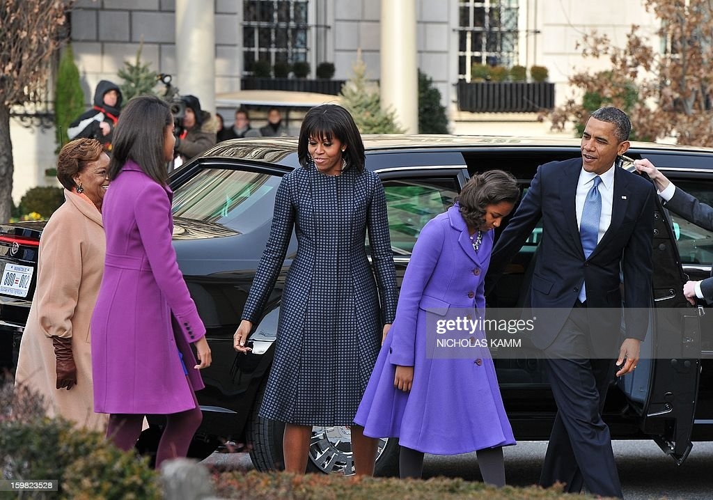 US President Barack Obama, First Lady Michelle Obama and their daughters Sasha(2nd-R) and Malia arrive at St. John's Church on January 21, 2013 in Washington, DC, hours before Obama participates in a ceremonial swearing in for a second term in office at the US Capitol. AFP PHOTO/Nicholas KAMM