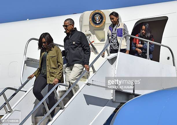 US President Barack Obama First Lady Michelle Obama and their daughters Sasha and Malia walk off Air Force One in Bariloche Argentina on March 24...