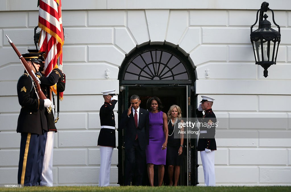 U.S. President <a gi-track='captionPersonalityLinkClicked' href=/galleries/search?phrase=Barack+Obama&family=editorial&specificpeople=203260 ng-click='$event.stopPropagation()'>Barack Obama</a>, first lady <a gi-track='captionPersonalityLinkClicked' href=/galleries/search?phrase=Michelle+Obama&family=editorial&specificpeople=2528864 ng-click='$event.stopPropagation()'>Michelle Obama</a>, and Vice President Joseph Biden's wife <a gi-track='captionPersonalityLinkClicked' href=/galleries/search?phrase=Jill+Biden&family=editorial&specificpeople=997040 ng-click='$event.stopPropagation()'>Jill Biden</a> come out from the White House to observe a moment of silence to mark the 12th anniversary of the 9/11 attacks September 11, 2013 on the South Lawn of the White House in Washington, DC. The nation is commemorating the anniversary of the 2001 attacks which resulted in the deaths of nearly 3,000 people after two hijacked planes crashed into the World Trade Center, one into the Pentagon in Arlington, Virginia and one crash landed in Shanksville, Pennsylvania.