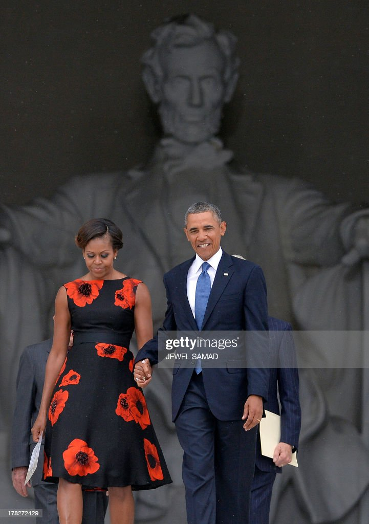 US President Barack Obama, First Lady Michelle Obama, former president Jimmy Carter and Bill Clinton arrive during the Let Freedom Ring Commemoration and Call to Action to commemorate the 50th anniversary of the March on Washington for Jobs and Freedom at the Lincoln Memorial in Washington, DC on August 28, 2013. The March on Washington is best remembered for King's stirring vision of a United States free of inequality and prejudice, telecast live to a nation undergoing a phenomenal decade of soul- searching, crisis and change. AFP Photo/Jewel Samad