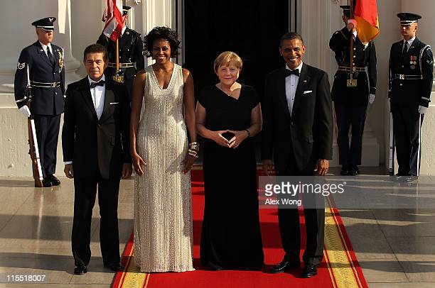 S President Barack Obama first lady Michelle Obama German Chancellor Angela Merkel and her husband Joachim Sauer pose for photographs on the North...