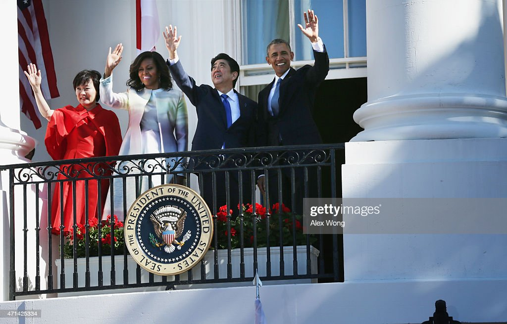 U.S. President <a gi-track='captionPersonalityLinkClicked' href=/galleries/search?phrase=Barack+Obama&family=editorial&specificpeople=203260 ng-click='$event.stopPropagation()'>Barack Obama</a> (R), first lady <a gi-track='captionPersonalityLinkClicked' href=/galleries/search?phrase=Michelle+Obama&family=editorial&specificpeople=2528864 ng-click='$event.stopPropagation()'>Michelle Obama</a> (2nd L), Japanese Prime Minister <a gi-track='captionPersonalityLinkClicked' href=/galleries/search?phrase=Shinzo+Abe&family=editorial&specificpeople=559017 ng-click='$event.stopPropagation()'>Shinzo Abe</a> (3rd L) and his wife <a gi-track='captionPersonalityLinkClicked' href=/galleries/search?phrase=Akie+Abe&family=editorial&specificpeople=2042808 ng-click='$event.stopPropagation()'>Akie Abe</a> (L) wave from the Truman Balcony during an official arrival ceremony at the White House April 28, 2015 in Washington, DC. The Japanese Prime Minister and his wife are on an official visit to Washington.