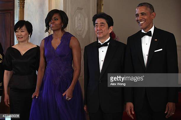 US President Barack Obama first lady Michelle Obama Japanese Prime Minister Shinzo Abe and his wife Akie Abe participate in a group photo prior to a...