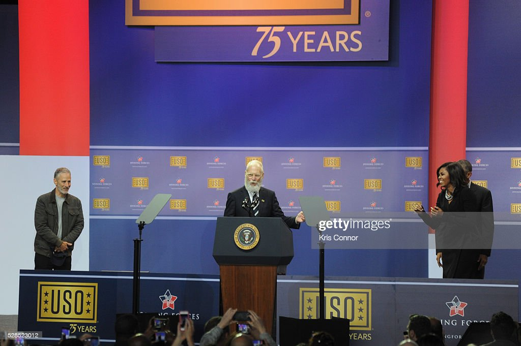 President <a gi-track='captionPersonalityLinkClicked' href=/galleries/search?phrase=Barack+Obama&family=editorial&specificpeople=203260 ng-click='$event.stopPropagation()'>Barack Obama</a> First Lady <a gi-track='captionPersonalityLinkClicked' href=/galleries/search?phrase=Michelle+Obama&family=editorial&specificpeople=2528864 ng-click='$event.stopPropagation()'>Michelle Obama</a>, <a gi-track='captionPersonalityLinkClicked' href=/galleries/search?phrase=Jon+Stewart&family=editorial&specificpeople=202151 ng-click='$event.stopPropagation()'>Jon Stewart</a>, and David Letterman speak during the 75th Anniversary USO Show at Joint Base Andrews on May 5, 2016 in Camp Springs, Md.