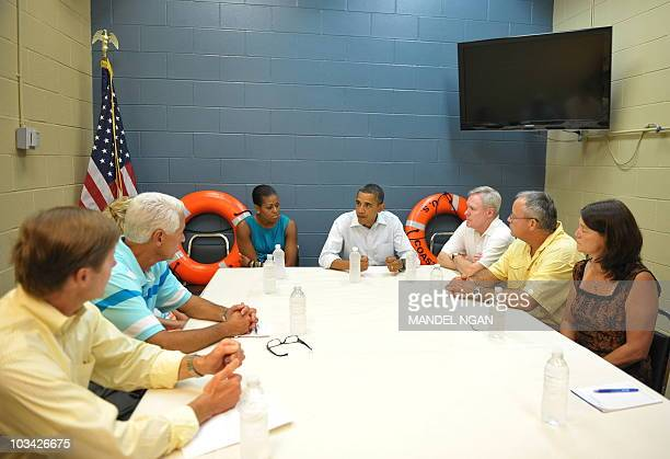 US President Barack Obama First Lady Michelle Obama Navy Secretary Ray Mabus and Florida Governor Charlie Crist take part in a roundtable discussion...