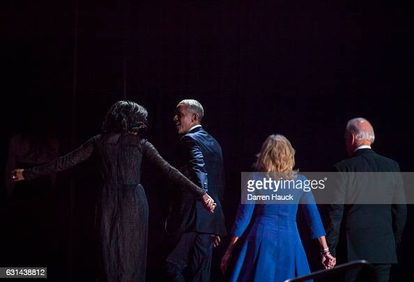 S President Barack Obama first lady Michelle Obama President Joe Biden and his wife Dr Jill Biden walk off stage after Obama's farewell address at...