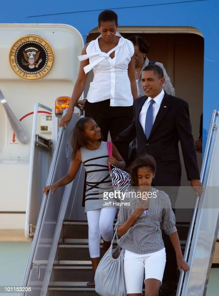 President Barack Obama first lady Michelle Obama their daughters Malia Obama and Sasha Obama and their grandmother Marian Robinson disembark from Air...