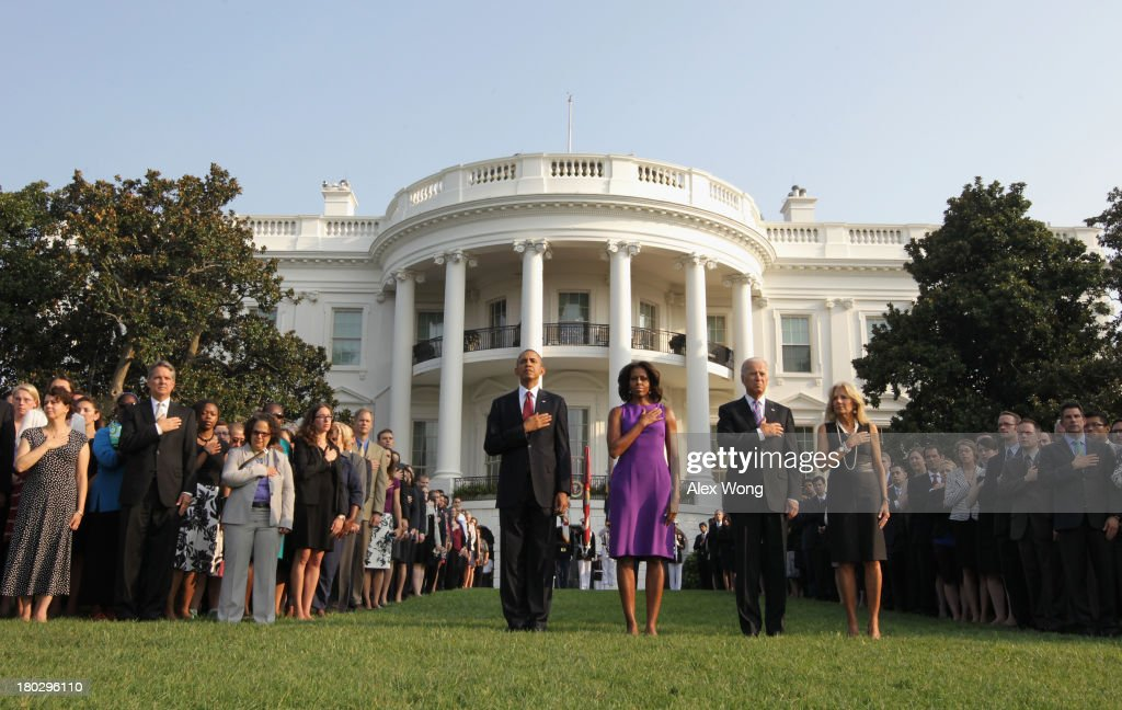 U.S. President <a gi-track='captionPersonalityLinkClicked' href=/galleries/search?phrase=Barack+Obama&family=editorial&specificpeople=203260 ng-click='$event.stopPropagation()'>Barack Obama</a>, first lady <a gi-track='captionPersonalityLinkClicked' href=/galleries/search?phrase=Michelle+Obama&family=editorial&specificpeople=2528864 ng-click='$event.stopPropagation()'>Michelle Obama</a>, Vice President <a gi-track='captionPersonalityLinkClicked' href=/galleries/search?phrase=Joseph+Biden&family=editorial&specificpeople=206897 ng-click='$event.stopPropagation()'>Joseph Biden</a>, his wife <a gi-track='captionPersonalityLinkClicked' href=/galleries/search?phrase=Jill+Biden&family=editorial&specificpeople=997040 ng-click='$event.stopPropagation()'>Jill Biden</a>, and White House staff observe a moment of silence to mark the 12th anniversary of the 9/11 attacks, September 11, 2013 on the South Lawn of the White House in Washington, DC. The nation is commemorating the anniversary of the 2001 attacks which resulted in the deaths of nearly 3,000 people after two hijacked planes crashed into the World Trade Center, one into the Pentagon in Arlington, Virginia and one crash landed in Shanksville, Pennsylvania.