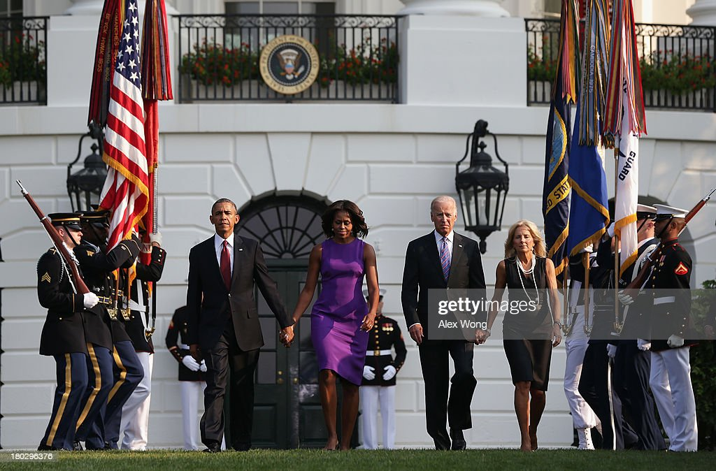 U.S. President <a gi-track='captionPersonalityLinkClicked' href=/galleries/search?phrase=Barack+Obama&family=editorial&specificpeople=203260 ng-click='$event.stopPropagation()'>Barack Obama</a>, first lady <a gi-track='captionPersonalityLinkClicked' href=/galleries/search?phrase=Michelle+Obama&family=editorial&specificpeople=2528864 ng-click='$event.stopPropagation()'>Michelle Obama</a>, Vice President <a gi-track='captionPersonalityLinkClicked' href=/galleries/search?phrase=Joseph+Biden&family=editorial&specificpeople=206897 ng-click='$event.stopPropagation()'>Joseph Biden</a>, his wife <a gi-track='captionPersonalityLinkClicked' href=/galleries/search?phrase=Jill+Biden&family=editorial&specificpeople=997040 ng-click='$event.stopPropagation()'>Jill Biden</a> come out from the White House to observe a moment of silence to mark the 12th anniversary of the 9/11 attacks September 11, 2013 on the South Lawn of the White House in Washington, DC. The nation is commemorating the anniversary of the 2001 attacks which resulted in the deaths of nearly 3,000 people after two hijacked planes crashed into the World Trade Center, one into the Pentagon in Arlington, Virginia and one crash landed in Shanksville, Pennsylvania.