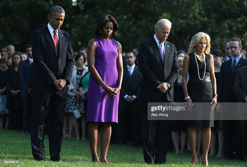 U.S. President <a gi-track='captionPersonalityLinkClicked' href=/galleries/search?phrase=Barack+Obama&family=editorial&specificpeople=203260 ng-click='$event.stopPropagation()'>Barack Obama</a>, first lady <a gi-track='captionPersonalityLinkClicked' href=/galleries/search?phrase=Michelle+Obama&family=editorial&specificpeople=2528864 ng-click='$event.stopPropagation()'>Michelle Obama</a>, Vice President <a gi-track='captionPersonalityLinkClicked' href=/galleries/search?phrase=Joseph+Biden&family=editorial&specificpeople=206897 ng-click='$event.stopPropagation()'>Joseph Biden</a>, his wife <a gi-track='captionPersonalityLinkClicked' href=/galleries/search?phrase=Jill+Biden&family=editorial&specificpeople=997040 ng-click='$event.stopPropagation()'>Jill Biden</a>, and White House staff observe a moment of silence to mark the 12th anniversary of the 9/11 attacks September 11, 2013 on the South Lawn of the White House in Washington, DC. The nation is commemorating the anniversary of the 2001 attacks which resulted in the deaths of nearly 3,000 people after two hijacked planes crashed into the World Trade Center, one into the Pentagon in Arlington, Virginia and one crash landed in Shanksville, Pennsylvania.